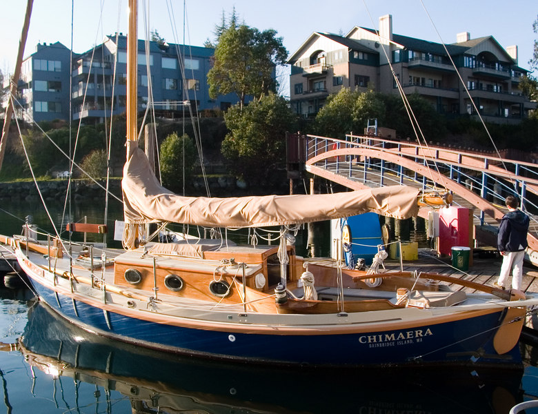 Admiring a nice wooden sailboat in the marina.