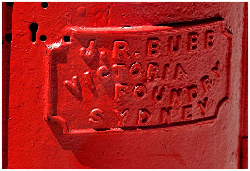 Friday September 2nd 2005. <br /> <br /> A close-up detail of one of the very few old, red painted, cylindrical iron postboxes left in the city. <br /> <br /> EXIF DATA <br /> Canon 1D Mk II. EF 70-200 f/2.8L@200mm 1/160s f/5.6 Shutter Priority ISO 200.