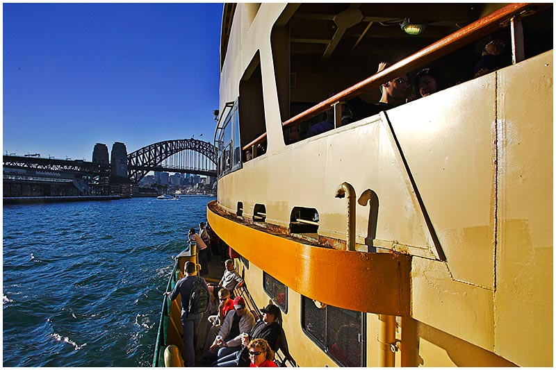 Sydney Harbour, Thursday September 8th 2005. <br /> <br /> On board the ferry to Manly. <br /> <br /> EXIF DATA <br /> Canon 1D Mk II. EF 17-35 f/2.8L@17mm 1/125s f/11 ISO 320.