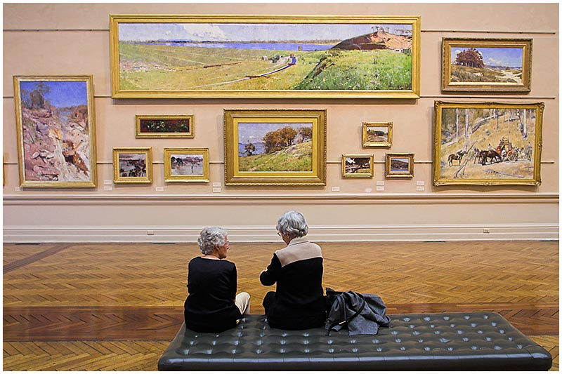 Art Gallery of New South Wales, Tuesday September 6th 2005. <br /> <br /> These two women are seated in front of paintings by Australian artist, Sir Arthur Streeton. Most of these works were painted in the 1890's.  <br /> <br /> EXIF DATA <br /> Canon 1D Mk II. EF 17-35 f/2.8L@17mm 1/50s f/3.2 ISO 400.