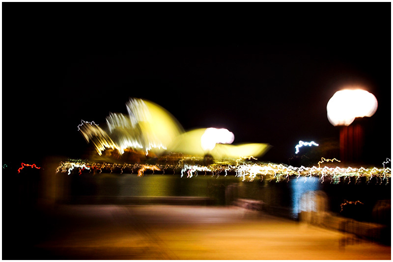 Sydney Harbour, Thursday September 15th 2005. <br /> <br /> A somewhat abstract image of the Opera House taken while handholding the camera during a long exposure. <br /> <br /> EXIF DATA <br /> Canon 1D Mk II. EF 17-35 f/2.8L@35mm 10secs f/8 ISO 200.