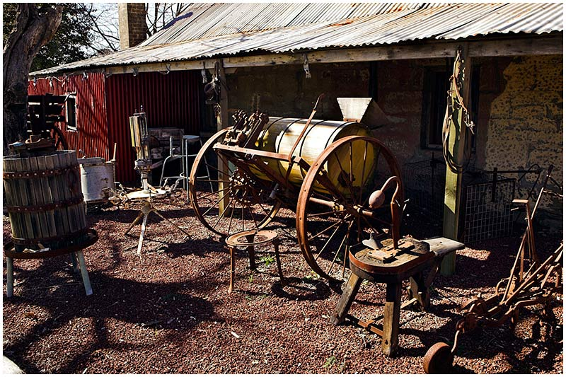 Gledswood Homestead & Winery, Camden, Friday September 16th 2005. <br /> <br /> A collection of old farmyard and wine making equipment. <br /> <br /> EXIF DATA <br /> Canon 1D Mk II. EF 17-35 f/2.8L@17mm 1/80s f/8 ISO 200.