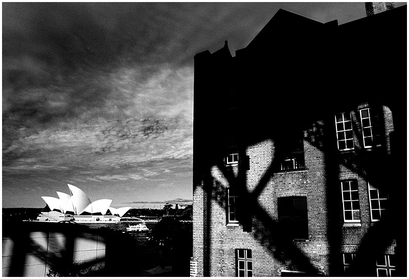 The Rocks, Friday September 23rd 2005. <br /> <br /> This former warehouse (now an apartment block) stands in the shadow of the harbour bridge. <br /> <br /> EXIF DATA <br /> Canon 1D Mk II. EF 17-35 f/2.8L@17mm 1/125s f/10 ISO 200.