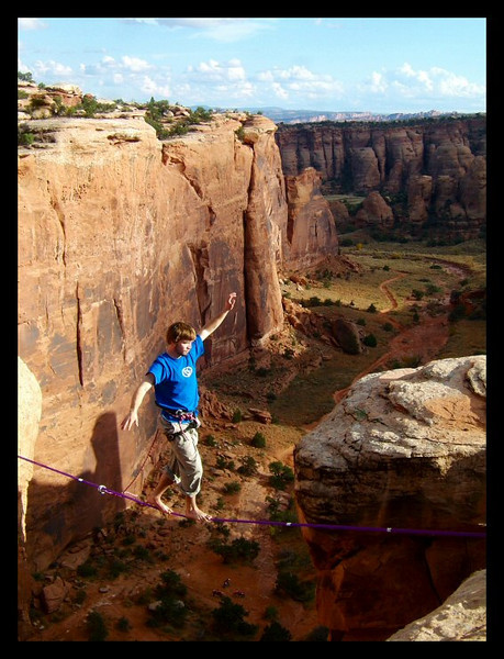 Dylan Buffington styles the skies above Bull Canyon on the Birthday Gap Highline, Moab, Utah.