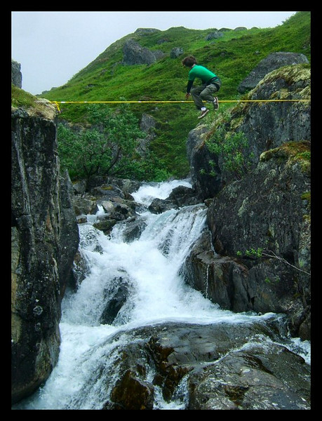 James Clulow attempts a catch on the Reed Creek Highline in Reed Valley.