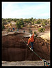 Larry Harpe sends the Dog Hole Highline as the sun sets over Gemini Bridges, Moab, Utah.