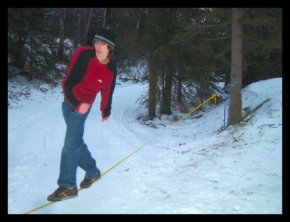 James Clulow enjoys the New Years Day slacklining fun on the hillside overlooking Anchorage.