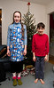Isabel and Benjamin in front of the tree at Grandparent's house in Falls Church