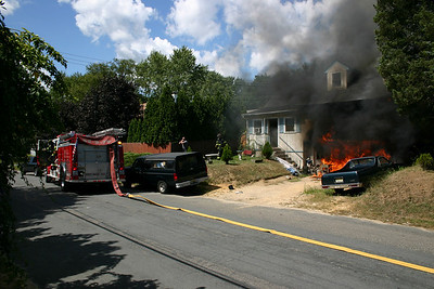 First arriving Glendola Engine 52-2-75 arrived to find heavy fire in the 2 car attached garage of a 2 story cape cod style dwelling rapidly extending to the living room above.