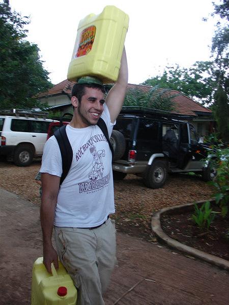 Pat Nulty carries water the Ugandan way