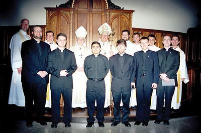 Bishop Schmitt Ordains Two to Diaconate