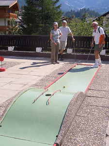 Gail, Peter and Dad at the minigolf course in Zermatt