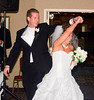 Bride and groom twirl into the reception