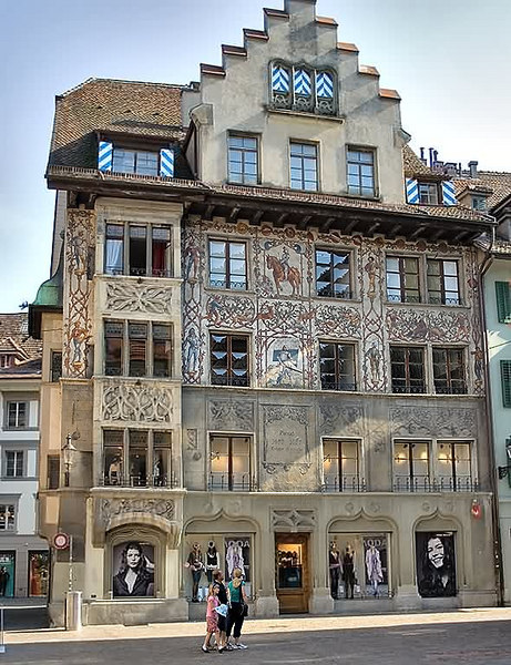 Old and new - the stone carving dates the building to 1677.  It houses a modern dress store