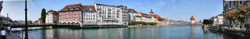 Here's panorama of the Lucerne 'Old Town'.  The panorama is framed by famous bridges on the right and left.  The far right is the Jesuit Church (more on this later).  Down the water is a famous octagonal water tower from 1300.  This is a Where's Waldo panorama as well.  Celeste is in the picture somewhere.
