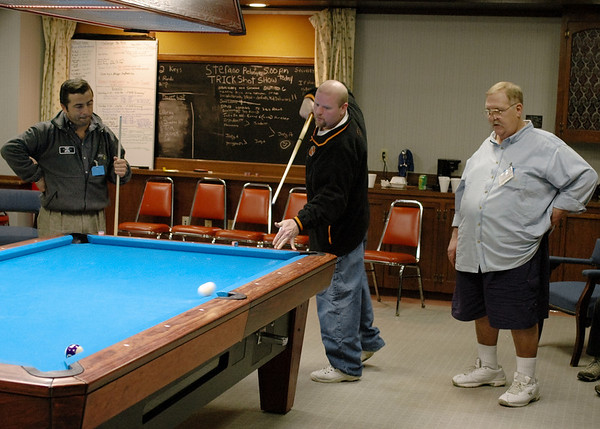 Stefano Pelingo watches Larry Nevel draw the cue ball several rails. That's the late 'Old Has Been' Tom Ferry on the right.