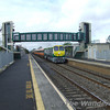 Ex-works 218 passes through Monasterevan with the Up Westport to Heuston. Sun 17.09.06