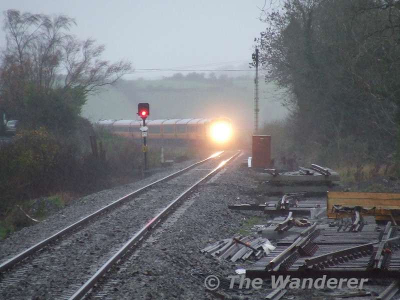 In the pouring rain 216 nears Manulla Jct with the 1425 Westport - Heuston. Sun 19.11.06
