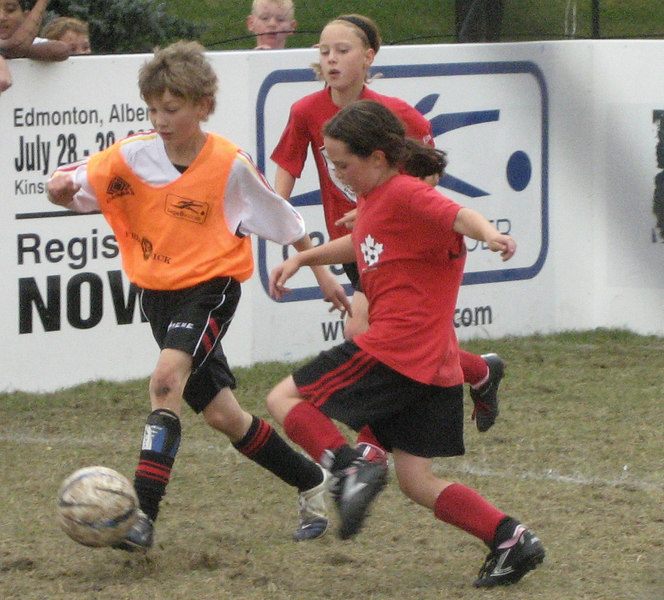 Rowan in a soccer tournament. They played 3-on-3 inside a small boarded area, and against boys' teams!