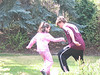 Rowan and Farran battling it out for posession of the soccer ball, in the back yard.