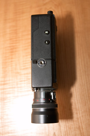 External light socket, filter selector button, and zoom buttons on the top. Zoom can also be actuated manually with the silver lever on the side of the lens