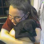 Natalia hugs her new puppy, Lena