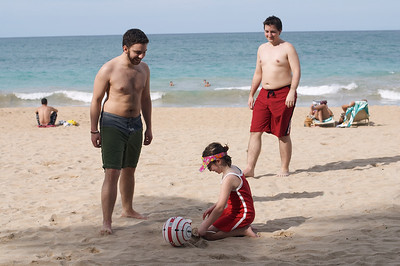 Natalia takes a break to play in the sand, but Andrs and Dan are having none of that