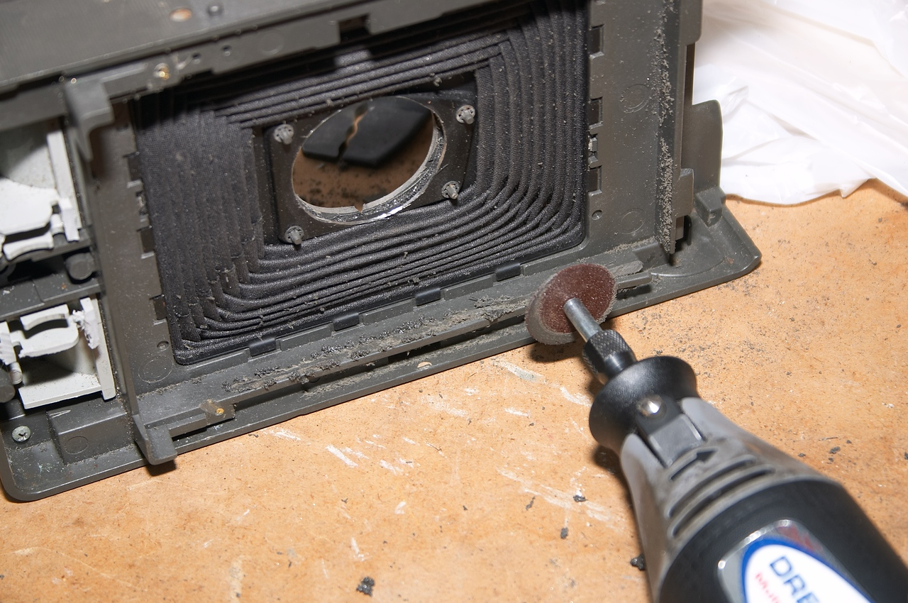 """Removing a strip of plastic that will obstruct the 4x5"""" image"""