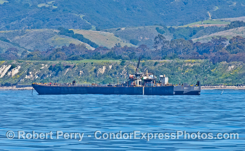 """Oil barge """"Jovalan"""" transports oil from offshore platform Holly to storage tanks on the beach.  Tow boats then take the barge to LA or SF"""