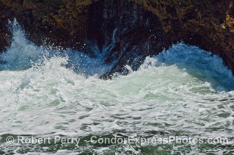 Waves crash across the rocky intertidal at the base of the sea cliffs on Santa Cruz Island