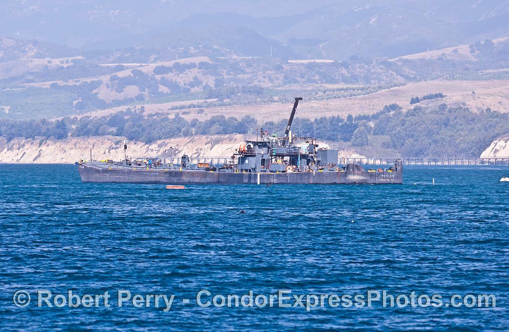"Oil transport barge ""Jovalan"" picking up oil from the Platform Holly storage tanks at Elwood."