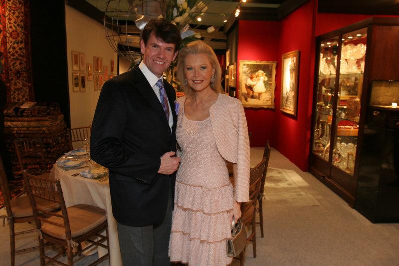 Joel Allen (Joel Allen Design Group, LLC) with Audrey Gruss in front of his table design.