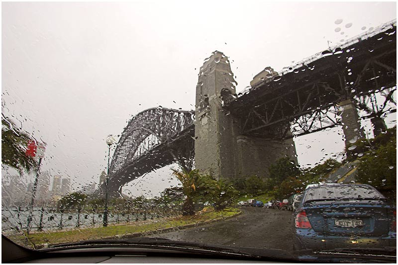 Sydney Harbour Bridge, Friday August 4th 2006. <br /> <br /> A wet winter's day in Sydney and a total contrast to yesterday's sunshine and warmth. <br /> <br /> <br /> EXIF DATA <br /> Canon 1D Mk II. EF 17-35 f/2.8L@17mm 1/80 f/14 ISO 400.