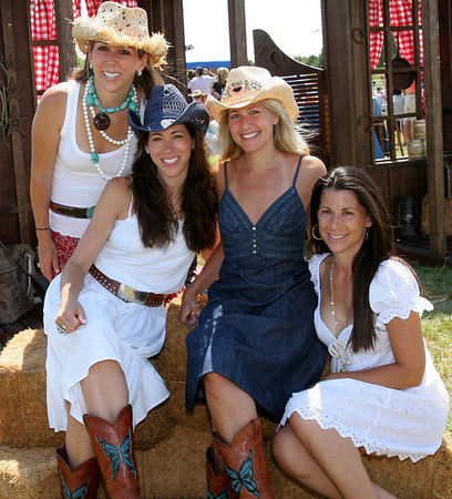 "Event Co-Chairs: Jackie Harris Hochberg, Roxanne Palin, Cathy Schwartz and Tasha Genatt at the Diamond Ranch in Watermill for The 17th Annual Family Day ""Wild, Wild West"" Carnival in the Hamptons hosted by the Albert Einstein College of Medicine National Women's Division-New York Chapter to benefit the campaign to support <a href=""http://www.aecom.yu.edu/home/pricecenter.asp"">The Michael F. Price Center for Genetic and Translational Medicine</a> at Einstein"
