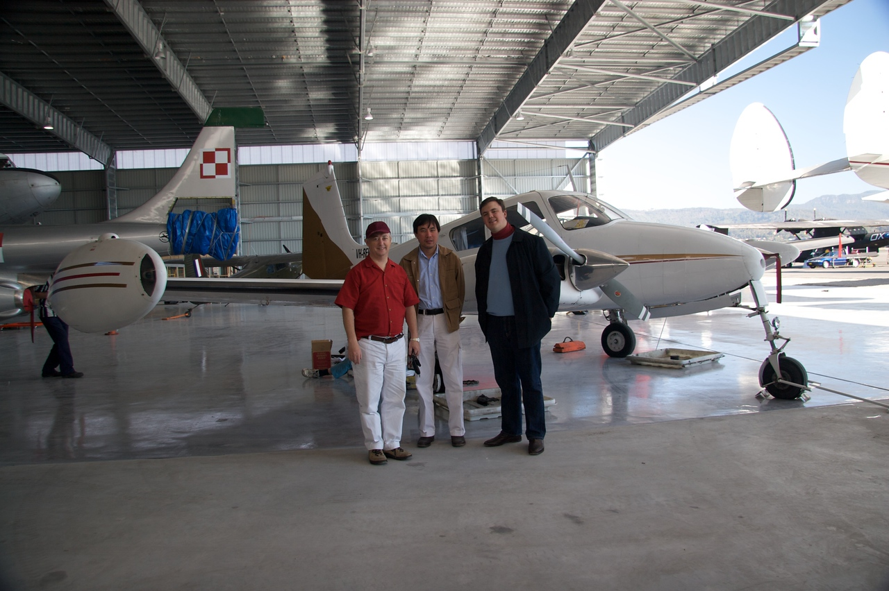 """In front of VH-REK • Michael, Phuong, and I stand in front of VH-REK, which was my uncle Jeremy's plane.  Jeremy enjoyed working with HARS before he died: he was in the team that brought the <a href=""""http://www.hars.org.au/fleet/constellation/index.html"""" title=""""Lockheed Super Constellation VH-EAG—Connie"""">Lockheed Super Constellation</a> from Tucson, Arizona to Australia."""