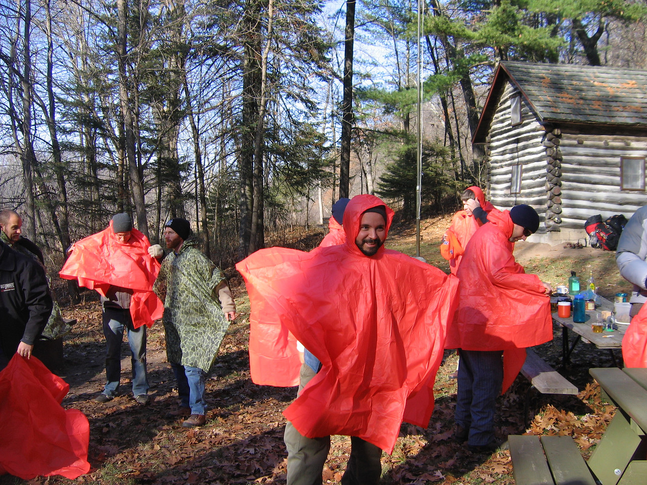 But the fun and games need to be put on hold for a while,  and the orange ponchos were donned for the burial service.
