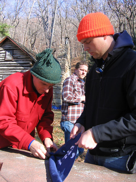 Jacob and Brad prepare Chad's ashes for burial.  They wrapped them in the Eagle Scout neckerchief.