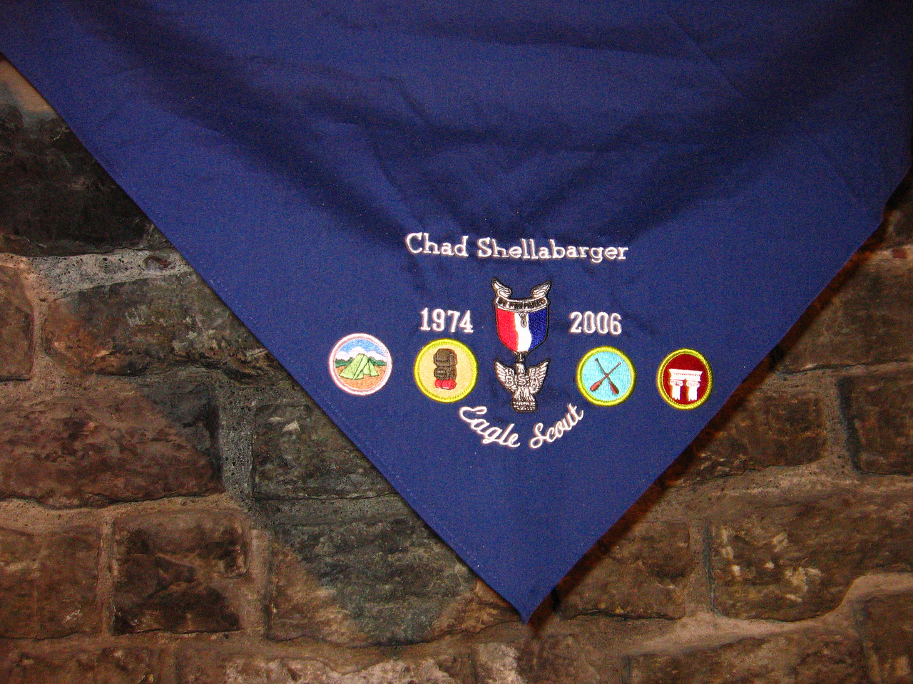 We adorned it with Merit Badges that we thought represented Chad well:  Camping, Backpacking, Paddling and Architecture.