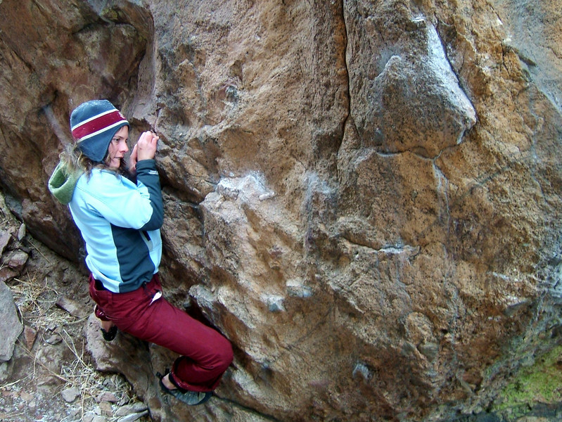 Lisa works the only dry section of rock on a cold and snowy day spent in Eldorado Canyon.