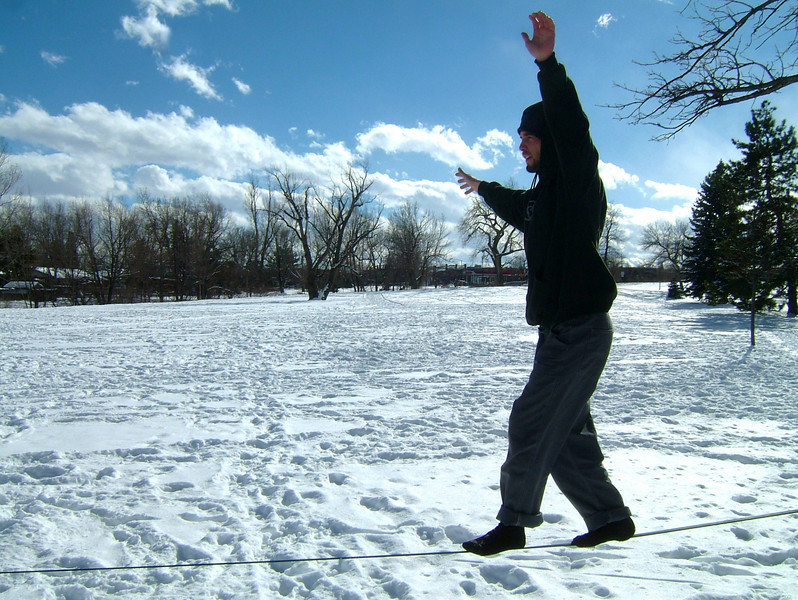 The snow doesn\'t slow Dylan down, walking the line in a park in Boulder.