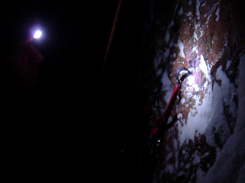 A headlamp and a hook.  Kelsey works his way upward.