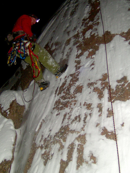 Side-by-side toprope self belay aid climbing by headlamp at midnight in January.  Kelsey scopes out his line.