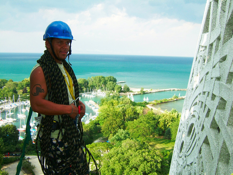 Kelsey works some ropes during the rigging for another rappel off the top of the temple.