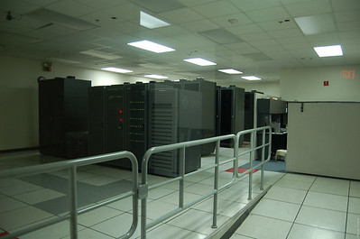 The UI ITS data center (NOC) in the Administration Bldg.  The machines in the foreground were mine -- from the right: Fire (ERP), ERP disk, UPS/Email disks, Rain (email), srs2, srs1 (SunRay server boxes).  Last two racks were/are Co-lo boxes.