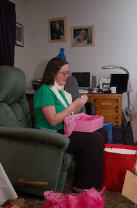 Elizabeth opens some gifts.