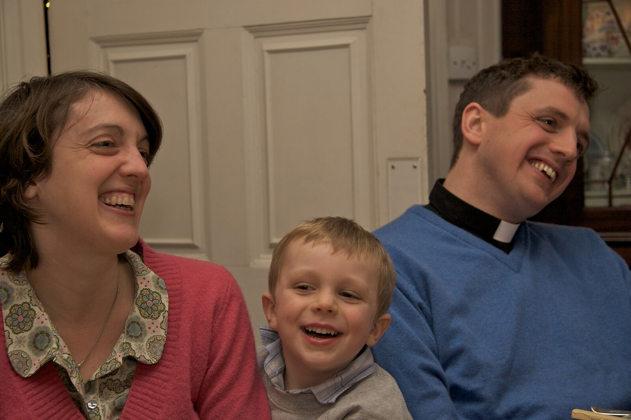 Sharing a joke • It looks like Francis is sharing a different joke from Lucy and John.