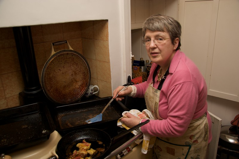 Mummy • Mummy heating up gravy for Christmas lunch.