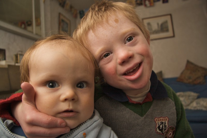 Edmund and Samuel • Samuel hugs his youngest brother, Edmund. I was pleased with this photo because Edmund was in fact sitting on my knee, so it's fortunate that the whole thing isn't horribly out of focus.