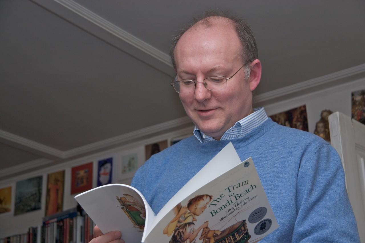 Amused • Philip examining 'The Tram to Bondi Beach', which Thomas had given to Samuel.