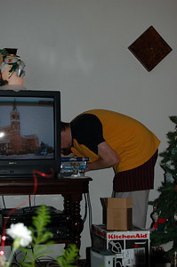 Curtis busies himself with connecting the XBox to the family TV.  Only to verify that it works, of course.